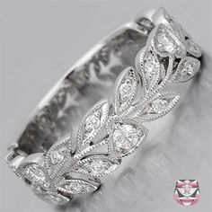 Wedding Bands - Diamond Wedding Band Nouveau Style: I usually like really giddy jewelry ... But I LOVE this ring