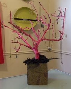 A branch is the perfect place to hang all of your jewelry! Spray paint it for a fun pop of color!