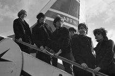 The Rolling Stones 'pop' group from left Brian Jones, Keith Richards, Mick Jagger, Charlie Watts and Bill Wyman, board a New York bound Airliner at London Airport October 23, 1964. They were off on a U.S. Tour. (AP Photo/Victor Boyton)