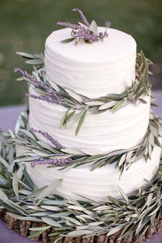 wedding cake - but you Could put this lavender  olive leaves around cheese wheels instead
