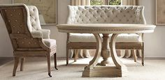 tufted piece with round dining table
