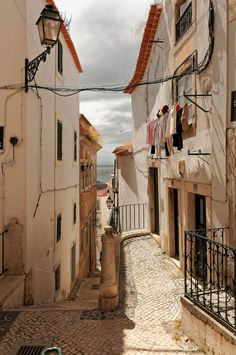 Alfama alley is the oldest district of Lisbon, spreading on the slope between the Castle of Lisbon and the Tejo river of Portugal