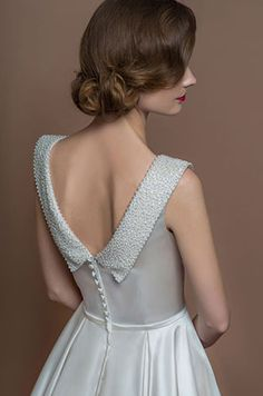 Agatha by Lou Lou from Adore Brides in Chelmsford 01245 356399. Short vintage dress with beading detail.