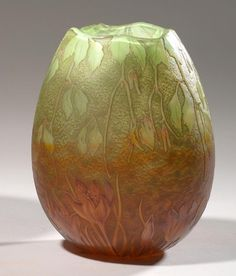 DAUM à Nancy. DAUM in Nancy Globular vase in multilayered glass taken with acid decorated with crocus and ivy. French Art Glass Vase.