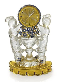 VAN CLEEF & ARPELS A FINE AND RARE ROCK CRYSTAL, YELLOW GOLD, SAPPHIRE AND DIAMOND SET DESK TIMEPIECE OF CHINOISERIE MOTIF NO 28088 CIRCA 1957