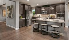 This open, modern kitchen in Mountain House, CA , was designed for entertaining   Charlene plan by Richmond American