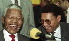 Nelson Mandela shares a laugh with fellow freedom fighter Allan Boesak in 1993 during his presidency of South Africa.