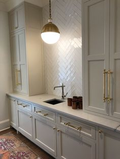 Brass hardware and white backsplash tile in Herringbone pattern. Brass hardware and white backsplash tile in Herringbone pattern. White Tile Backsplash, Kitchen Backsplash, Kitchen Countertops, Diy Kitchen, Awesome Kitchen, Kitchen Cabinets, 10x10 Kitchen, Gray Cabinets, Kitchen Paint