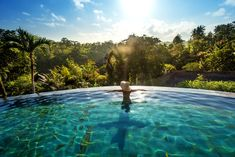 Woman sunbathing in infinity swimming pool at luxurious resor , Beach Honeymoon Destinations, Romantic Honeymoon, Travel Destinations, Beach Vacations, Honeymoon Ideas, Places To Travel, Places To Go, Bali Holidays, Exotic Beaches