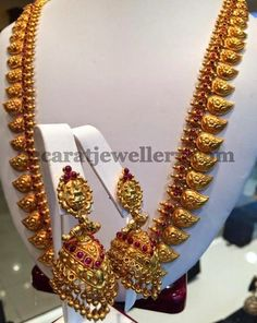 Jewellery Designs: Gold Mango Haram with Lakshmi Jhumkas