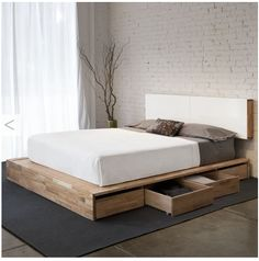 Platform bed in English walnut with drawers
