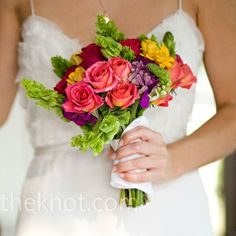 Bouquet - vibrant-colored roses, zinnias and green poms broken up with longer stems of bells of Ireland
