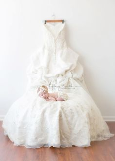newborn on mom's wedding dress - www.TiffanySmithP...