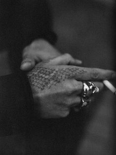 I find this so incredibly sexy...the tattoo, the rings, the cigarette...even the pose of the hands.  I want to see what the rest of him looks like!