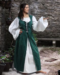 "Made from 100% Cotton fabric, the Ameline Peasant Dress is a bodice with attached skirt. The bodice is laced to fit with brass grommets, and the full skirt is split down the front to show a modest peek of a muslin underdress, sold separately.   <a href=""http://store.pearsonsrenaissanceshoppe.com/dcsizechartdress.html"">Size Chart</a>"