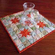 A sqaure batik table topper with bright orange stars made from batik fabric squares. Etsy Christmas, Tablerunners, Quilted Table Runners, Fabric Squares, Potholders, Table Toppers, Beige Color, Earthy, Coasters