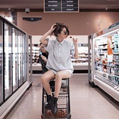 "The ""Looking Flawless While Perfectly Balancing on a Shopping Cart and Sucking a Popsicle"" shot. 