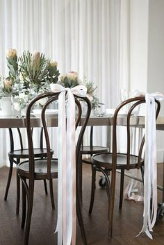Brentwood chairs with simple but sophisticated narrow ribbon bows trailing to the floor. Source: My.Sweet.Love #chairdecor #weddingchair