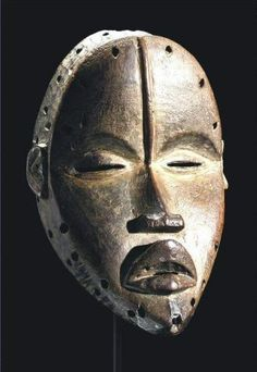 Dan Tankagle Mask, Ivory Coast Description of exceptional age and finely carved, pierced at the perimeter for attachment, the pointed chin beneath the full, downturned lips and thin nose leading to a medial ridge bisecting the slit eyes, '4230' in white pigment at the reverse; fine aged and encrusted medium brown patina. Dimensions height 9 in. 23cm - READ notes
