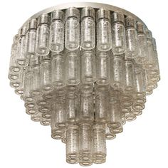 A giant 4 tiers RAAK ceiling lamp att. to Carl fagerlund 1960's | From a unique collection of antique and modern chandeliers and pendants  at http://www.1stdibs.com/furniture/lighting/chandeliers-pendant-lights/
