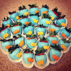 Under the Sea themed babyshower. Dipped strawberries into blue candy chocolate. Used goldfish as fish, white sugar balls as bubbles and graham cracker crumbs as sand