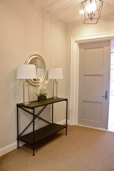 Absolutely LOVE! Walls are Benjamin Moore - Gray Owl; Door is Benjamin Moore - Storm.