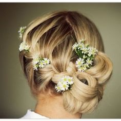 Get inspired: Daisies in a romantic side updo.. #Wedding perfect!