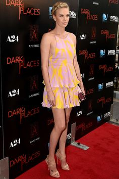 Charlize Theron in a delicious lemon-strawberry sundae themed Dior mini-dress | July 24, 2015