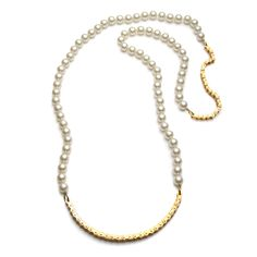 Love how the pearls dress-up the gold-plated bike chain and the chain makes the pearls playful. fallon, Classique Long Pearl Necklace, $138.