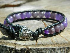 Chan Luu inspired, single wrap leather bracelet with all natural Amethyst, genuine black leather, and a sterling silver button! This piece was a custom order, but can be made again!! Check out more of my jewelry on Facebook at: http://www.facebook.com/pages/LL-Beads/192717604154556 !!