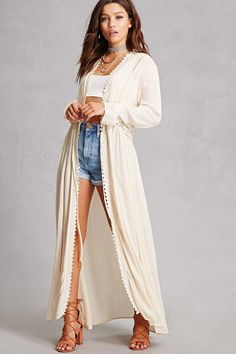 A crinkled woven longline cardigan featuring a crochet trim along the front, a self-tie drawstring waist, and long sleeves. This is an independent brand and not a Forever 21 branded item.