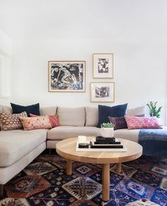 Love the pillows and the rug combo.