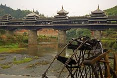 Chengyang Bridge - Sanjiang of Guangxi Province, China.  The bridge is a combination of painting, bridge, corridor, veranda and Chinese pavilion. It has two platforms (at the two ends of the bridge), 3 piers, 4 spans, 5 pavilions, 19 verandas, and three floors.