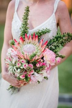 Exquisite Bridal Bouquet Comprised Of: King Protea, Pink Spray Roses, Blush Dahlias + Additional Blush & White Florals, Green Air Plant, Scabiosa Pods + Unique Greenery and Foliage
