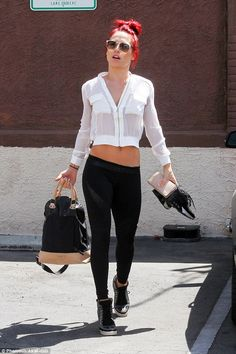 Tummy flaunting: Pro dancer Sharna Burgess, 30, showed off her midriff in a cropped top