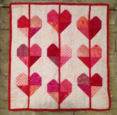 Fiddlesticks and Humility: scrappy hearts ... tutorial included.  Maybe make these tumbling or into a bunting style table runner?
