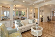 Like the overall look. For an open concept, note the columns with cabinet and arches. Would work between DR and Great Room. Like board and batten paneling in foyer.