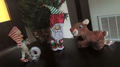 Elf wrapped as santa