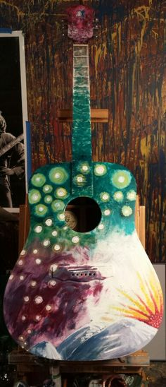 The first guitar ive painted!  New project of painting on unusable musical instruments as well as handpainted stage ready instruments!  More to come. #paintoninstruments #paintonguitar #jenniperlsteinpainting #recycledart #upcycledart #guitarart #guitar #ashevillelocalart