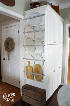 I love this idea. It's great for storing over-sized platters and cutting boards that don't fit in kitchen cabinets. 9 Ingenious Small Kitchen Storage Ideas: A DIY Plate Rack    #diy_plate_rack #kitchen_storage #small_space_decor @oliverandrust