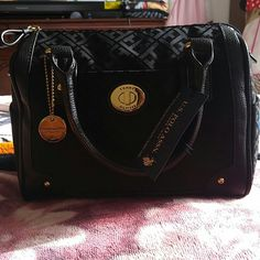 Black Tommy Hilfiger Purse All black, Midi/small Hand bag. Lightweight. Completely New.  Got it for Christmas from my aunt but it's not my style. Tommy Hilfiger Bags Mini Bags