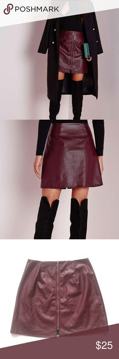 """NWT Missguided Faux Leather Zip Front Mini Skirt Faux leather zip front skirt by Missguided. Oxblood burgundy color, gold front zipper, lining. Tagged as size 14 (I believe this may be a UK 14, so more equivalent to a US 10. Please refer to provided measures for best fit). Approx measures lying flat: 15"""" waist, 18"""" length. NWT  •Lowball offers declined/no trades •ask questions before buying •unfair ratings from buyers are reported & buyer blocked - I don't misrepresent products; what you see…"""