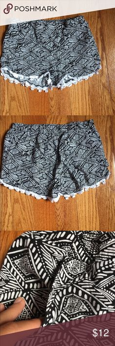 Super cute White & Black shorts with designs These black and white shorts have a really cute design. On the bottom of the shorts there are little flares I would like to say. These shorts do have pockets but only on the sides on the 3rd pic shown. Not in the back. Size 10/12 Bottoms Shorts