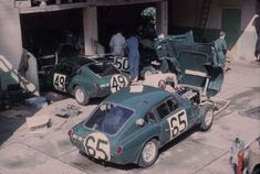 he Triumph Spitfires of the Standard Triumph team being worked on in the Hotel de France during the 1964 24 Heures du Mans we see the n°65 car of Jean-François Piot & Jean-Louis Marnat, the n°49 car of Mike Rotschild & Bob Tullius & the n°50 car of David Hobbs & Rob Slotemaker only one of 3 cars finished, the n°50 car of Hobbs & Slotemaker, coming home in 21st place, 77 laps down on race winners Jean Guichet & Nino Vaccarella (in the Ferrari 275P)