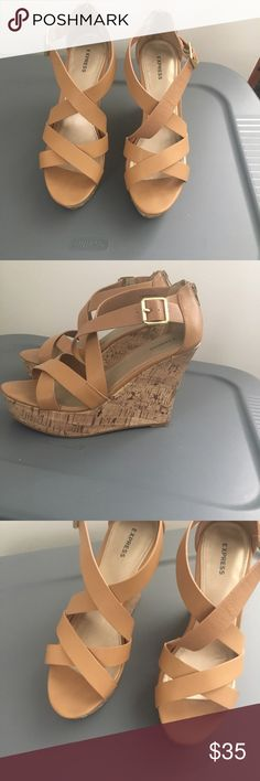 Express tan wedges, preloved These shoes are in good condition. There are signs of wear in the front of the shoes, not the leather. Shoes Wedges