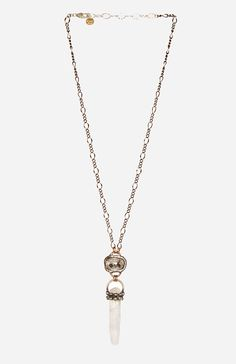 Brass chain link necklace featuring a silver shade Swarovski crystal with a raw quartz pendant. By Mikal Winn.