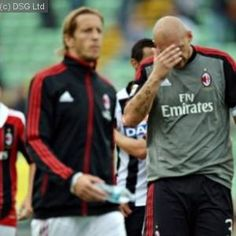Massimiliano Allegri's tenure as coach of Serie A giants AC Milan came under fresh scrutiny when the Rossoneri suffered their third defeat of the season in a 2-1 reverse away to Udinese.
