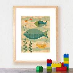 Art for the ocean room, a small piece for a narrow wall: Fish Baby from Petit Collage, bought on serious sale. UPDATE: Framed in a white wood frame and hung. Looks great!