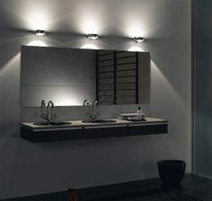 Modern bathroom lighting fixtures over mirror