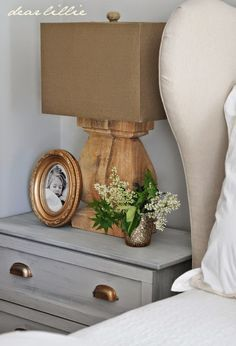 Night stand or end table styling: as a general rule of thumb, no more than three items per surface. A book, face down, sleeve removed, is an alternative to items pictured above.